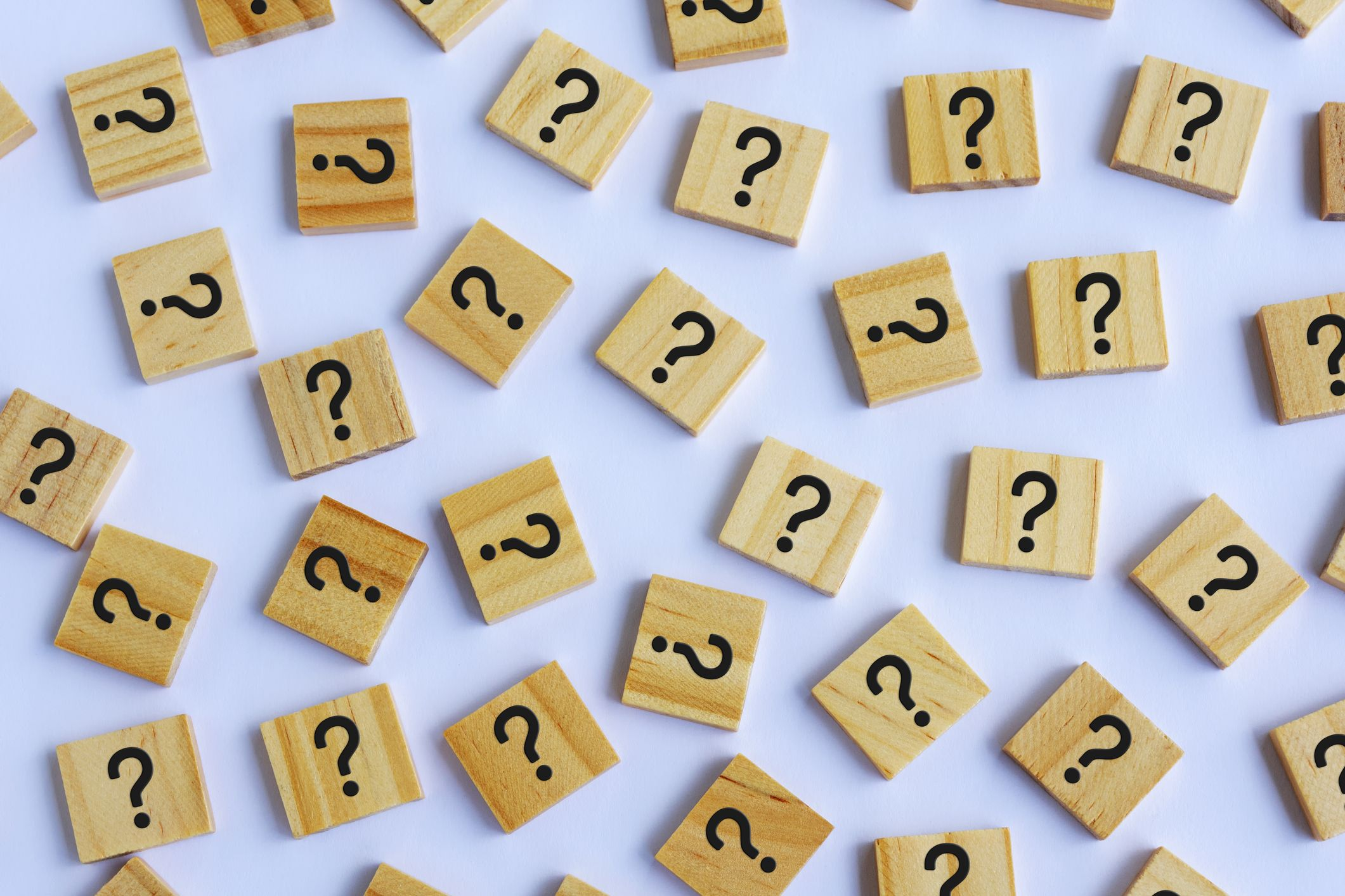 question-marks-on-wooden-block-white-background-royalty-free-image-1578060820